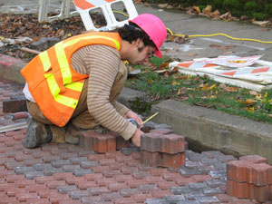 Photo: Installing pavers by hand