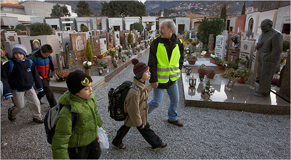 Dave Yoder for The New York Times  Gianfranco Frizzera, a volunteer in a program aimed at reducing vehicle emissions, walked children to school through a cemetery in Lecco, Italy.