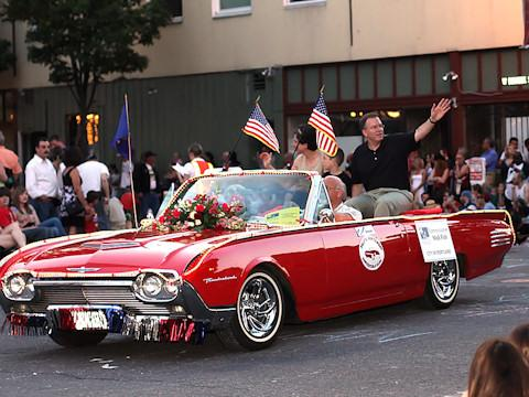 Commissioner Nick Fish waves to the crowd from a vintage 1960s Thunderbird during the 2009 Portland Rose Festival Starlight Parade.