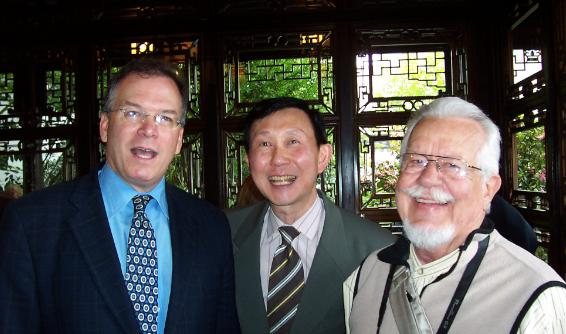 Commissioner Nick Fish with former Portland Mayor Bud Clark and Philip Tang at the 10th anniversary celebration of Portland's Classical Chinese Garden