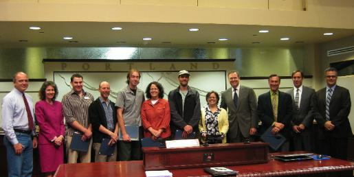 Joining Commissioner Fish and his Council colleagues were (left to right) Bo Bullock of Schoolhouse Supplies, Joe Connell of the Habitat for Humanity ReStore, Dave Haskins of Free Geek, Roz Babener of Community Warehouse, Tom Patzkowski of The ReBuilding Center, Kelley Carmichael Casey of SCRAP, and Multnomah County Commissioner Jeff Cogen