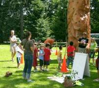 A travelling rock wall, donated by Al Roker's Lend A Hand program, stops in Montavilla Park for the Summer Playground Program kickoff with City Commissioner Nick Fish.