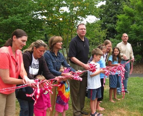 Commissioner Fish at the ribbon-cutting of Parkrose's new Senn's Dairy Community Garden