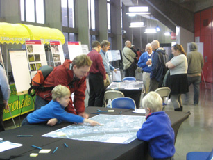 Open House Attendees look over aerial maps of the N/NE Quadrant