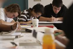 three students studying at a table