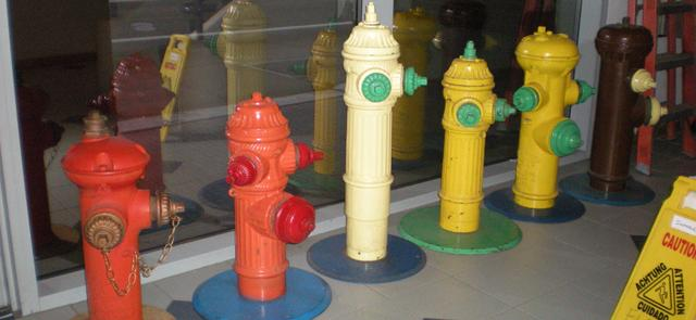 Hydrants of different sizes and colors on display.