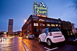 Car2Go car on W Burnside with Portland, OR sign