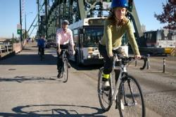 People biking over Hawthorne Bridge