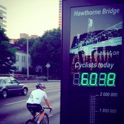 photo of bicyclist and Hawthorne Bridge counter