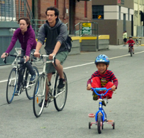 Happy family on bikes