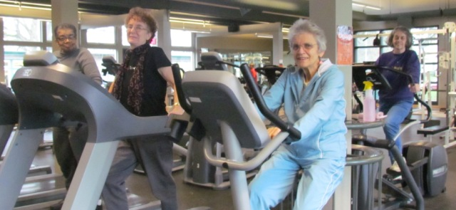 Seniors on treadmills and stationary bicycles