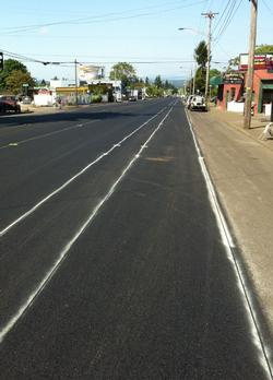 Partially completed bike lane striping on Cully