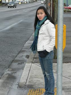 Pedestrian waiting at a crossing