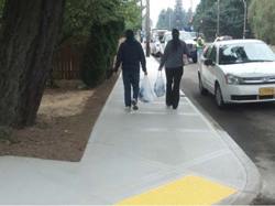 Walking on a new sidewalk with curb ramp