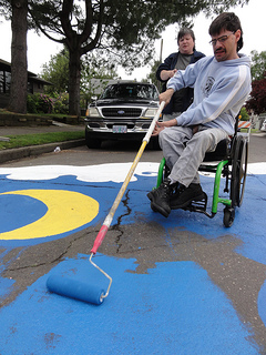 Guy in Wheelchair paints intersection