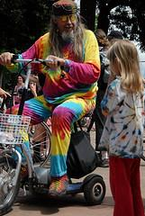 Man on scooter in tie dye