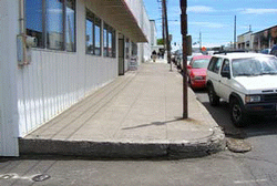 unimproved curb and sidewalk