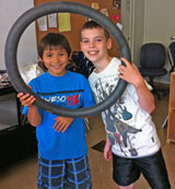 Kids repairing bike inner tube