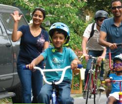 A family enjoys walking and biking on Sunday Parkways