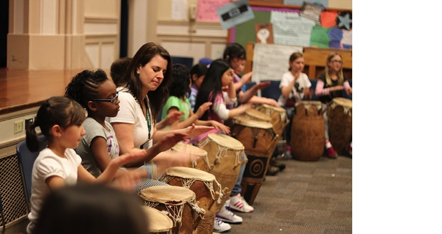 RACC staff drumming with children