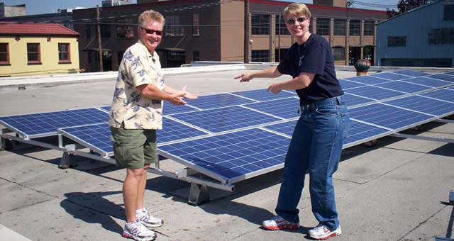 Owners showing solar panels on roof