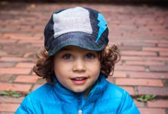 Child wearing the T-Ball style hat