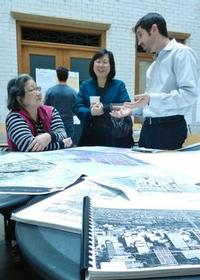 Staff discusses district plans with open house attendees