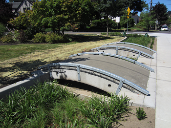 Pocket park with green streets and Big Pipe section footbridges