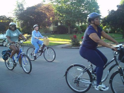 Three women on bikes