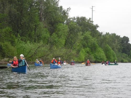 People paddling canoes