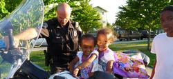 Little girls on an officer's motorcycle