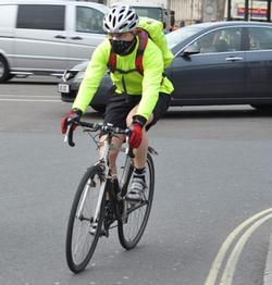 Person on bicycle wearing a facemask