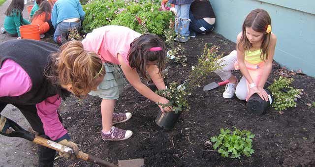 Kids planting native plants on Earth Day