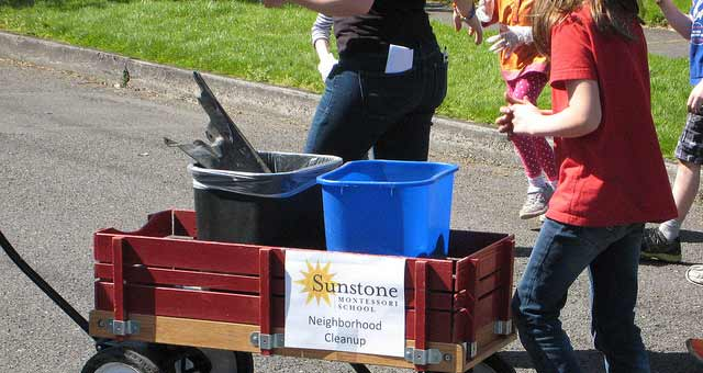 Kids using wagon for neighborhood cleanup
