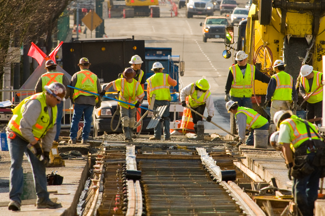 Construction crew working on streetcar tracks