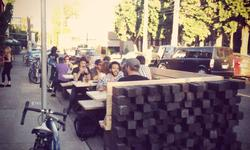Diners at the Street Seat in front of Bonfire Lounge