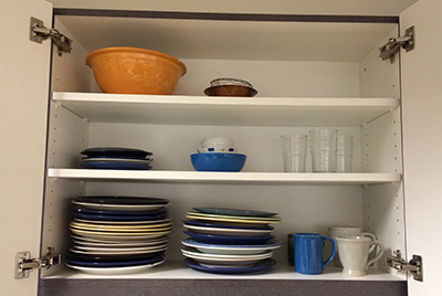 Durable dishware stored in cabinet
