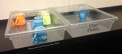 Reusable mugs in a conference room