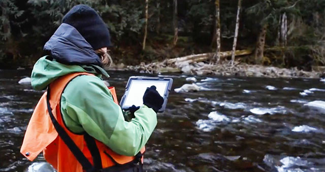 Woman monitors river using ipad