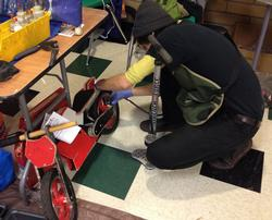 Mechanic working on a balance bike