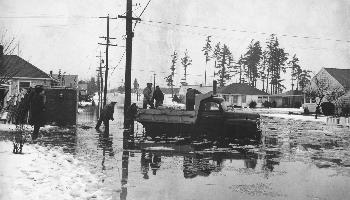 truck and people in water 1964 flood