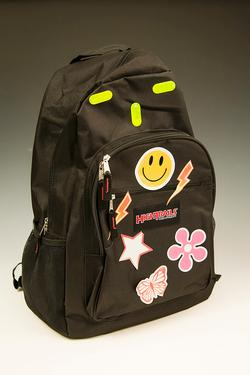 Black backpack with bright stickers