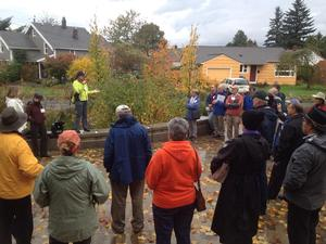 people on tour of trees and stormwater projects