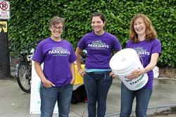 Three volunteers with donation bucket