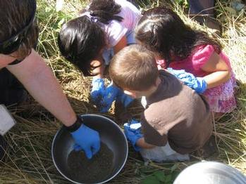 children from the community help collect soil samples