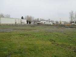an industrial lot and former horse barn location