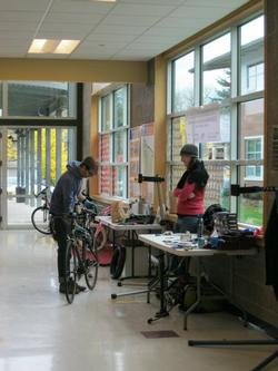 Volunteers fix bikes at Fix It Fair