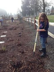 young volunteer working at park
