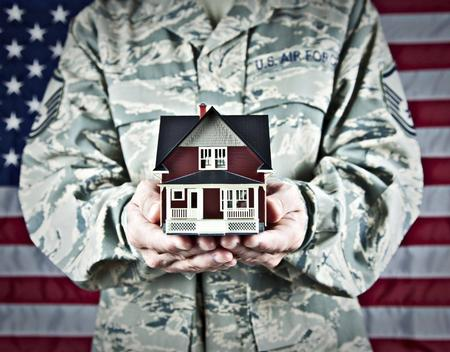 Image of Veteran Holding Model House in Hands