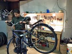 Matt Martin works on a bike at Rosewood Bikes